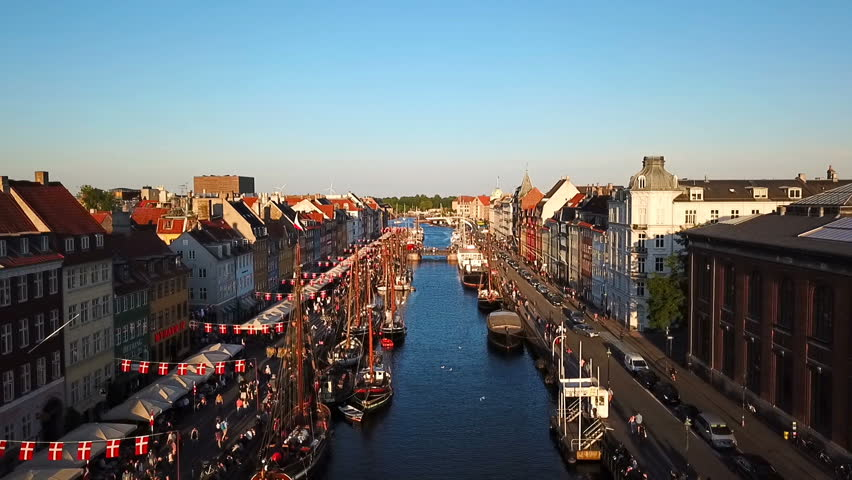 amazing busy old street in Copenhagen, Denmark. bridge in Nyhavn New Harbour canal and entertainment district. Aerial Video footage view from the top.
