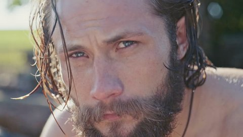 close up on the face of a bearded man