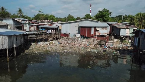 Plastic garbage from poor shanty town pollutes ocean