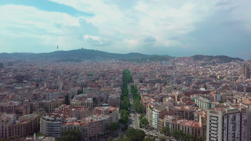 Aerial view de Espa a in Barcelona, Spain. Roundabout city traffic, top view. 4K video