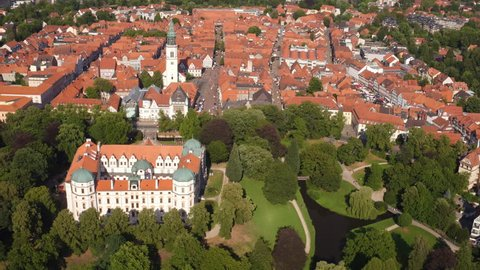 Celle, Germany - 07-29-2016: aerial view of historic castle and church on a sunny day in a German town