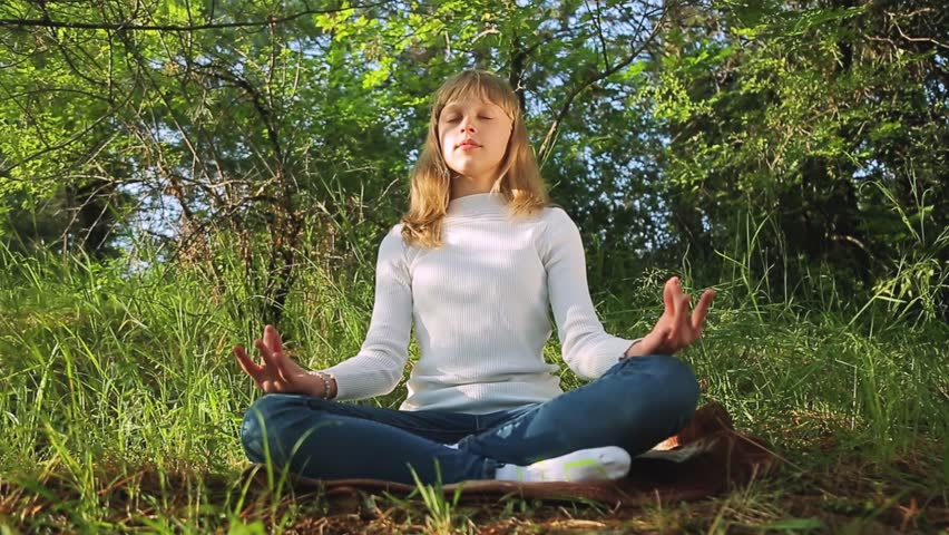 Teenage girl meditating practicing yoga at sunset in the forest | Shutterstock HD Video #1012210169