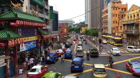 KUALA LUMPUR - SEPT 2017: A lot of vehicles drive past Chinatown, commonly known as Petaling Street, time lapse. There are lots of budget hotels and cheap food in this neighborhood.