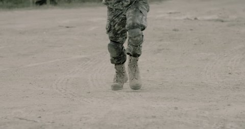 Soldiers feet running - slow motion  - graded version