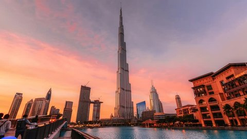 Cityscape of Dubai in the sunset time with Burj khalifa in the background and Souk Al Bahar in the foreground, Dubai, UAE
