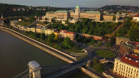 Budapest, Hungary - 4K aerial view of Buda Castle Royal Palace at sunrise with Clark Adam square and Szechenyi Chain Bridge