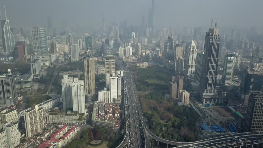 Shanghai multilevel Road Junction traffic cars ride Elevated overpass complicated urban Technology Skyscrapers glass Unique cityscape modern technology construction Sunny. Aerial flight backgrounds