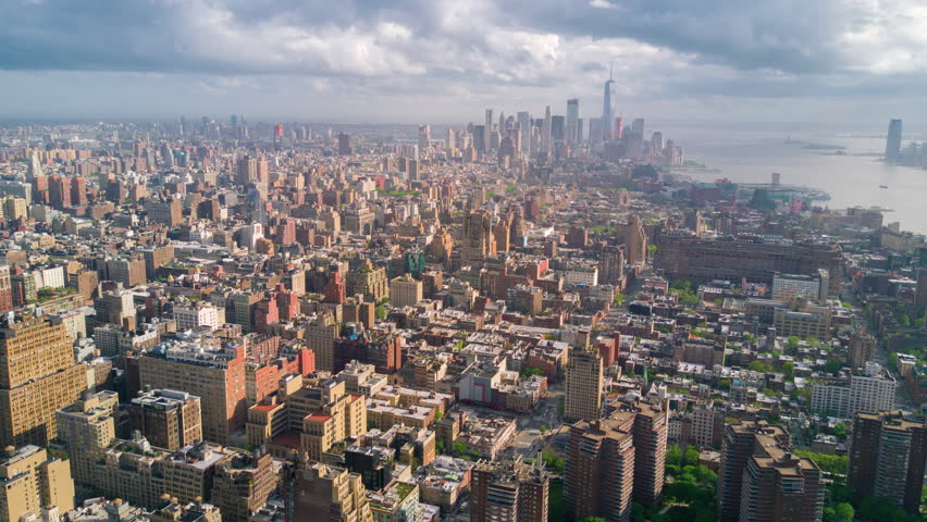 Aerial view of Manhattan, New York City. Tall buildings. Sunny day, aerial timelapse dronelapse. Clouds on background. | Shutterstock HD Video #1012402199