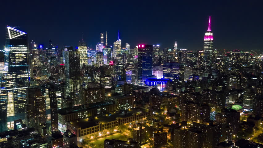 Aerial night view of Manhattan, New York City. Tall buildings. Timelapse dronelapse. NY from above. | Shutterstock HD Video #1012402229