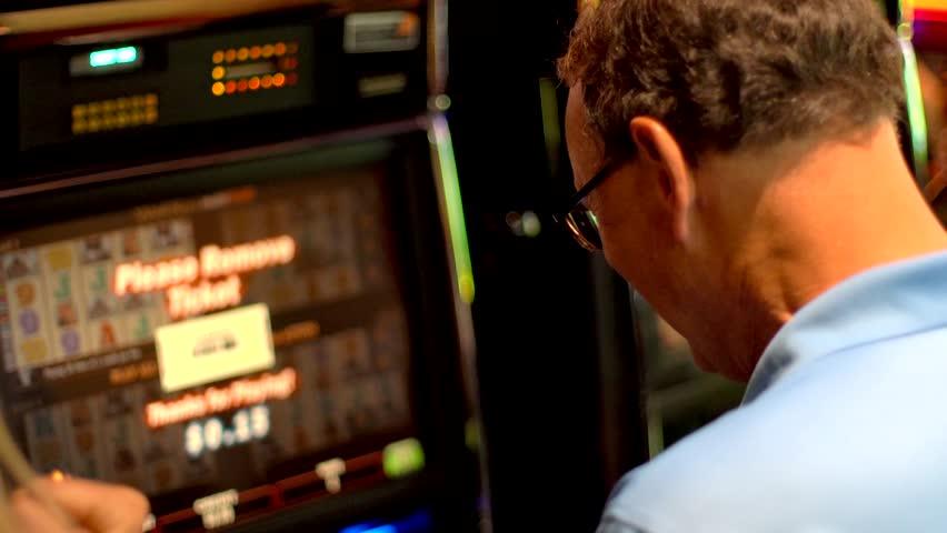 Senior man plays slot machine and wins | Shutterstock HD Video #1012405739