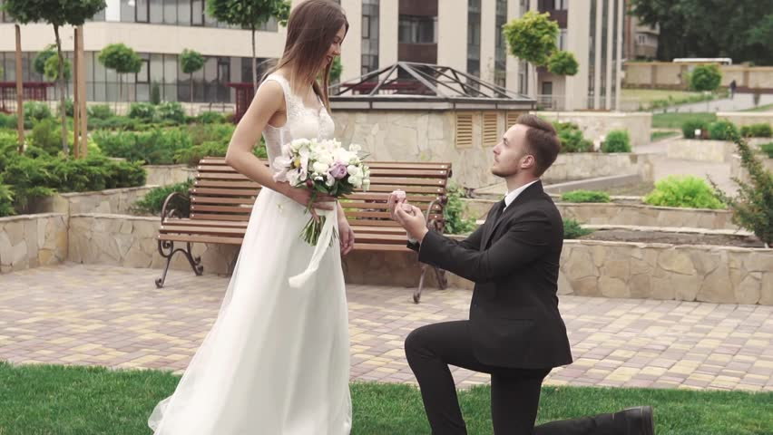 The young man proposes marriage to his beautiful girl.   Shutterstock HD Video #1012470569