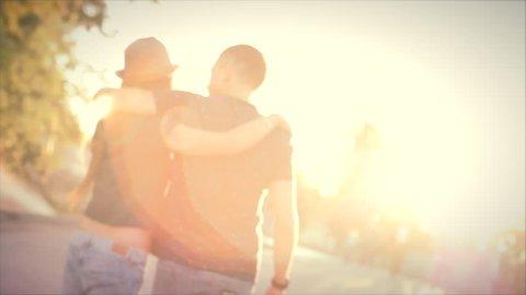 Woman hugging boyfriend feeling sad in love other in the sun. Stock footage