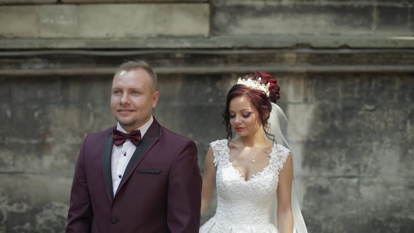 Lovely wedding couple standing together in the city | Shutterstock HD Video #1012519079
