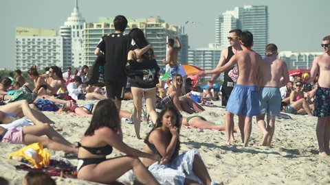 Crowded Miami South Beach at spring break time. Beach full of people in a sunny day - April 2018: Miami, Florida, US