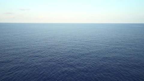 Aerial shot of open ocean. Flight over of open sea.