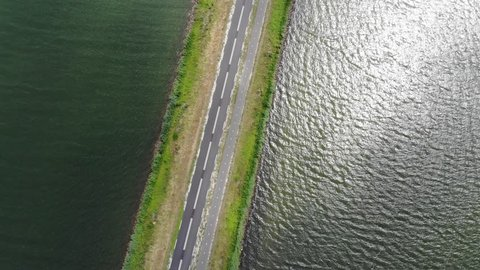 A Dutch highway through the polder with both left and right from the road the water and the sea