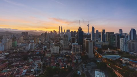 Time lapse: Beautiful Kuala Lumpur city view during dawn overlooking the city skyline from night to day. Full HD 1080p. Zoom in motion timelapse.
