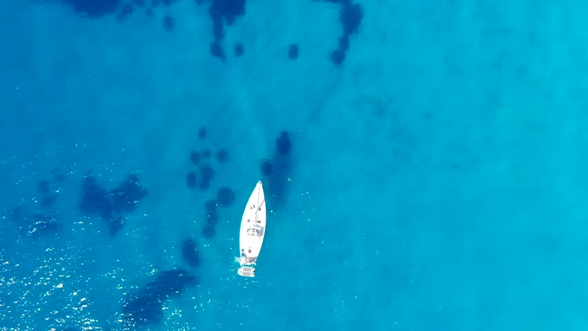 Aerial view on boat in blue colorfull sea with nice waves Scilla Italy