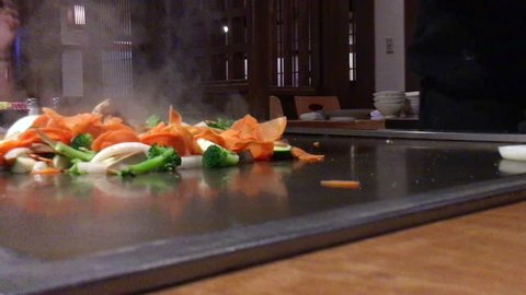 Hibachi teppanyaki style table food preparation in a Japanese steakhouse
