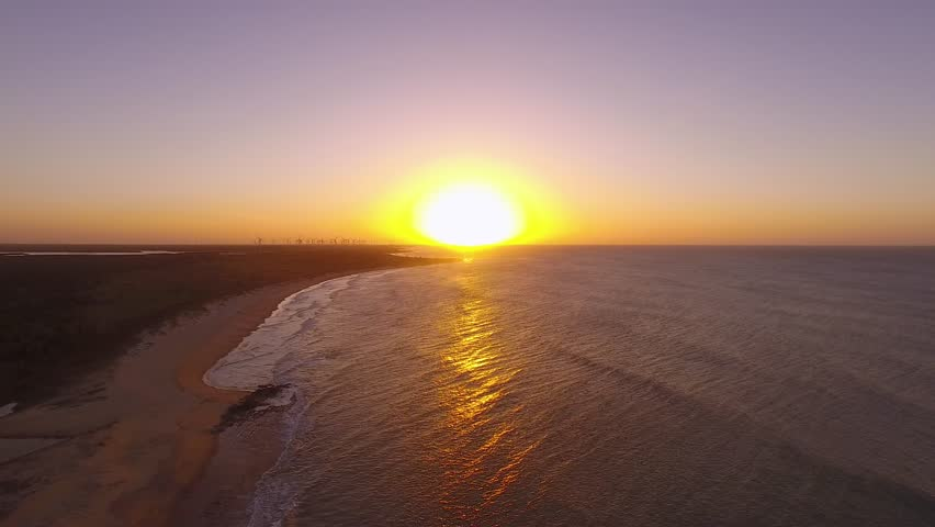 Sunset on the beach with beautiful sky     Shutterstock HD Video #1012576439