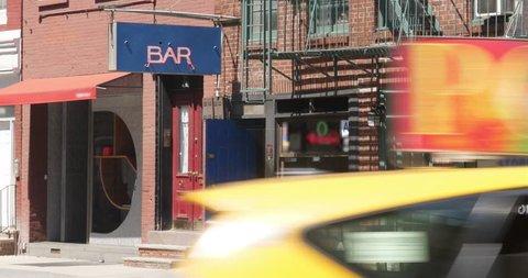 A daytime summer establishing shot of a typical Manhattan bar entrance.