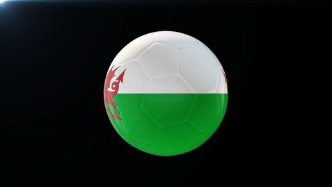 Football with flag of Wales, soccer ball with Welsh flag, sports equipment rotating on black background, 3D animation