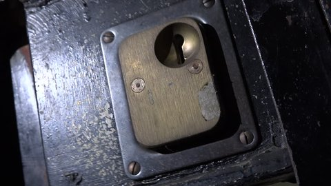Prison door slams shut obscuring white light through window