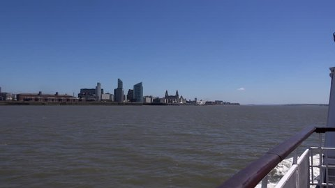 4K POV from Ferry of Liverpool Skyline Liver buildings and waterfront