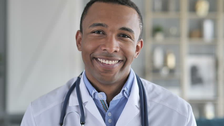 Portrait of Smiling Confident African-American Doctor #1012793129