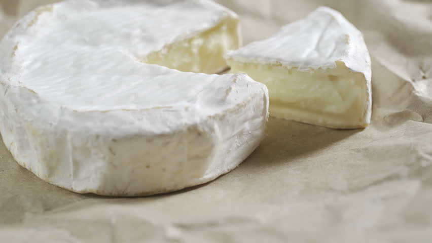 Portion of rotating creamy Camembert as detailed 4k footage | Shutterstock HD Video #1012799849