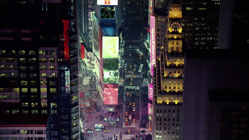 Aerial view of a large, busy city at night. View of Time Square in New York City. Shot with a RED camera. 4k footage.