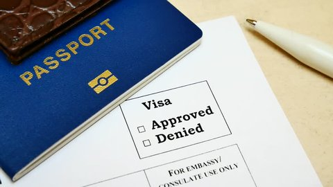 The decision to grant a visa. Pen voting approved in checkbox in blank visa application form