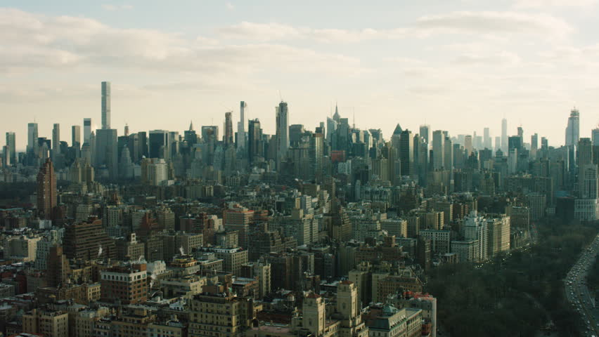 Aerial view of a large urban city during the day. Shot of skyscrapers in New York City. 4k footage. Shot with a RED camera.