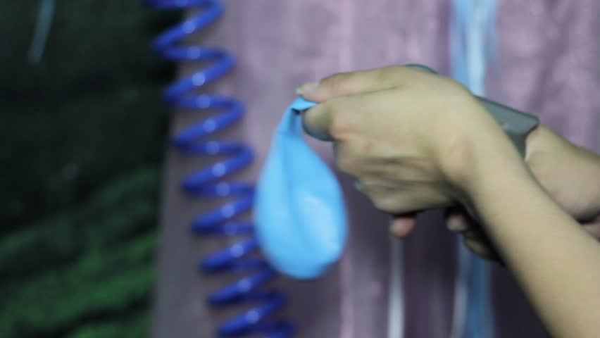Working process of inflating a balloon with gas helium from a metal gas cylinder #1012901549