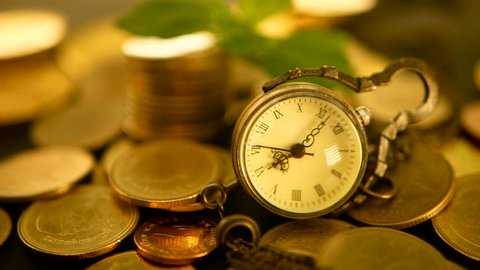 Management efficiency, time is money. Vintage pocket watch with golden coins stack and green leaf, black background. Time for Success of Finance Business. Investment, business financial ideas concept