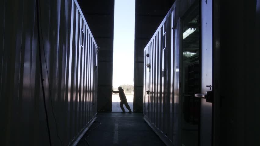 Warehouse Worker Pushing Metal Door.  | Shutterstock HD Video #1012967129