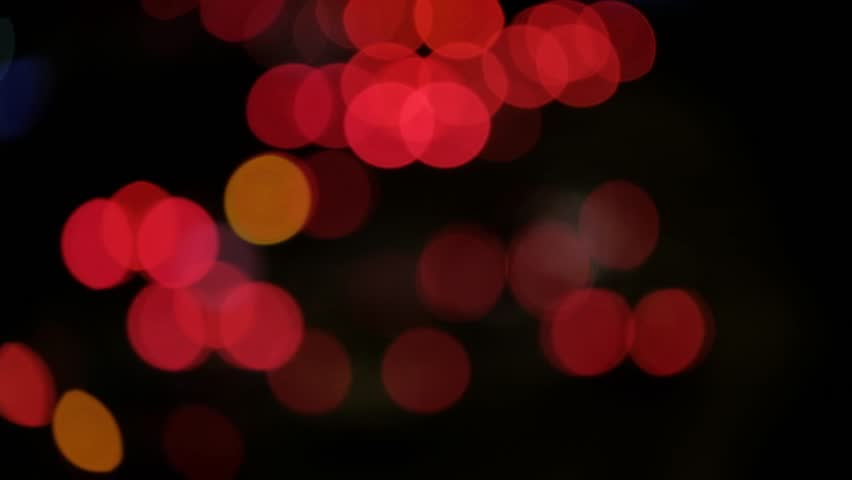 Bokeh from street lights and cars at night. | Shutterstock HD Video #1012990079