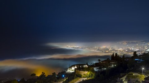 Beautiful Time lapse of a foggy night, over the see at Fuengirola and Mijas. It was shot from the Stupa of Benalmadena over the mountains during 2 hours.