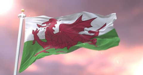 Flag of Wales waving at wind in slow at sunset, loop
