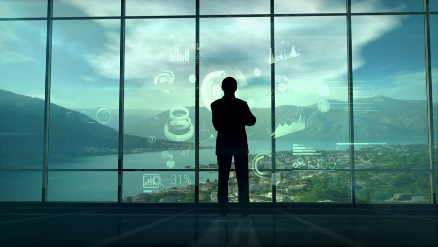 Businessman silhouette and infographics of the future | Shutterstock HD Video #1013070809