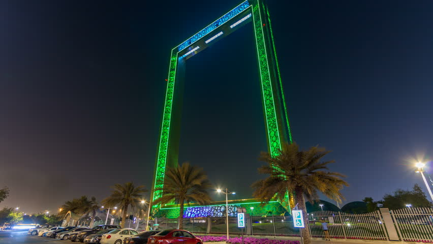 DUBAI, UAE - CIRCA MARCH 2018: Dubai Frame building at night timelapse with illumination, new UAE attraction. View from car parking aith palms. The frame measures 150 meters high and 93 meters wide