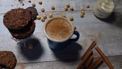Baker's dusting powder cinnamon falls into hot milk.  Slow motion 240 fps