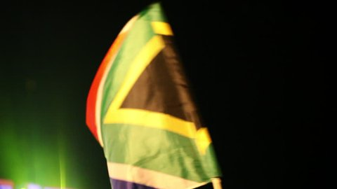 South African Flag Being Waved at Night
