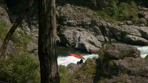 Distant shot of two rafters battle the whitewater on the Yoshino River in Tokushima Japan