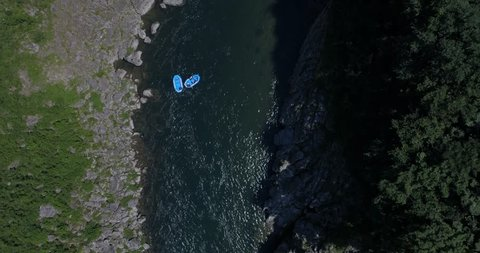Top down aerial shot of two rafts floating down the Yoshino River in Tokushima Japan