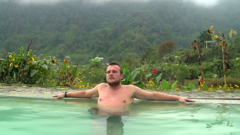 The man farts in the pool with thermal water