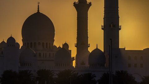 Sheikh Zayed Grand Mosque in Abu Dhabi at sunset timelapse, UAE. Evening view from Wahat Al Karama