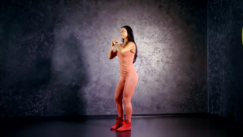 Girl professional athlete teaches you to perform the exercise back lunges. muscle group of the glutes and hamstrings. training at home. | Shutterstock HD Video #1013249579