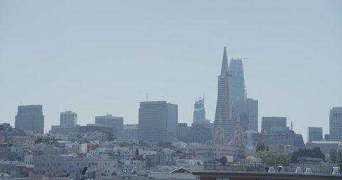 day Wide establishing San Francisco skyline cityscape then pan over see Coit Tower (San Francisco,1/5/18)