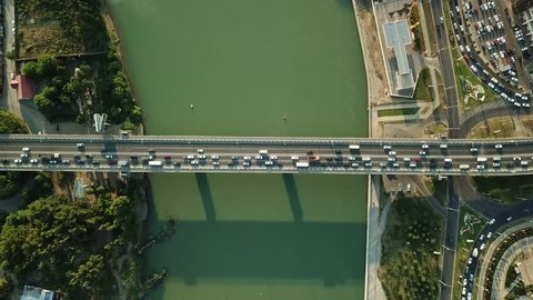 Aerial Drone Flight View of freeway busy city rush hour heavy traffic jam highway.  Aerial view of the vehicular intersection,  traffic at peak hour with cars on the road and on the bridge.